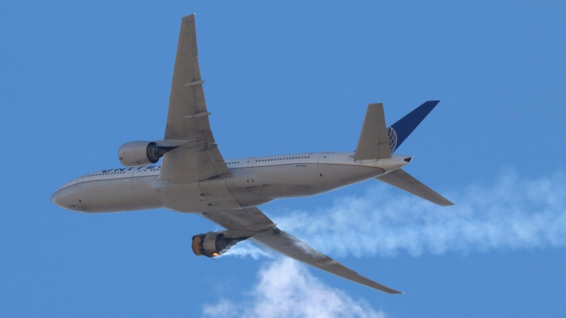 "This Saturday, Feb. 20, 2021 photo provided by Hayden Smith shows United Airlines Flight 328 approaching Denver International Airport, after experiencing ""a right-engine failure"" shortly after takeoff from Denver. (Hayden Smith via AP)"