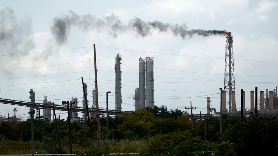 Winds blow the smoke from a refinery, Wednesday, Aug. 26, 2020, in Port Arthur, Texas. (AP Photo/Eric Gay)