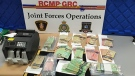 Two men have been arrested and police seized cocaine and over $62,000 in cash after searching five locations in P.E.I. as part of a cocaine trafficking investigation. (Photo via P.E.I RCMP)