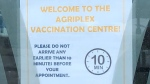 A sign in the door of the COVID-19 vaccination centre at the Western Fair District Agriplex in London, Ont. is seen Monday, Feb. 22, 2021. (Jim Knight / CTV News)