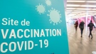A sign for a COVID-19 vaccination clinic is shown in Montreal, Sunday, February 21, 2021, as the COVID-19 pandemic continues in Canada and around the world. THE CANADIAN PRESS/Graham Hughes