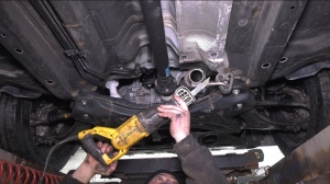 Mechanic Al Saikaley examines a car that recently had a catalytic converter stolen. The piece is part of engine, and is being targeted by thieves. (Leah Larocque / CTV News Ottawa)