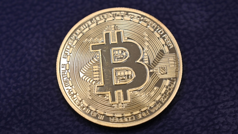 This photograph taken on Dec. 17, 2020 shows shows a physical imitation of a Bitcoin. (Ozan Kose/AFP/Getty Images/CNN)