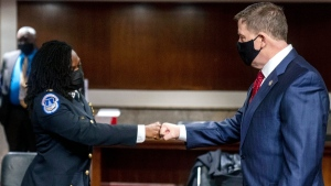 Former U.S. Capitol Police Chief Steven Sund, right, and Capitol Police Captain Carneysha Mendoza, left, greet each other before they testify before a Senate Homeland Security and Governmental Affairs & Senate Rules and Administration joint hearing on Capitol Hill, Washington, on Feb. 23, 2021. (Andrew Harnik / AP)