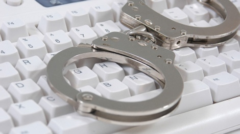 Handcuffs on a keyboard