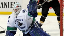 Vancouver Canucks goalie Andrew Raycroft makes a save against the Anaheim Ducks in the first period of a NHL hockey game in Anaheim, Calif., Friday, Oct. 30, 2009. (AP Photo/Chris Carlson)