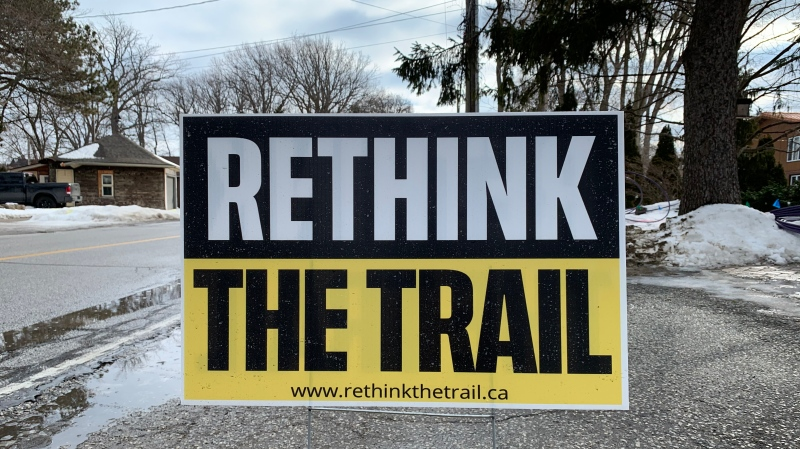 'Rethink the trail' sign in the front yard of a home on Riverside Drive East in Tecumseh, Ont. on Tuesday, Feb. 23, 2021. (Stefanie Masotti/CTV Windsor)