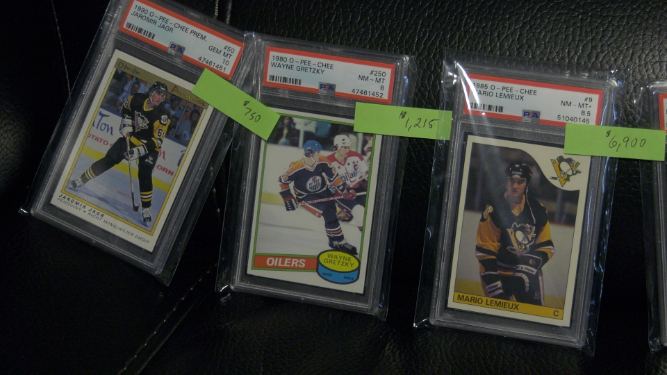 Some graded hockey cards, priced in the thousands of dollars. (Nate Vandermeer / CTV News Ottawa)