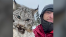 Farmer Chris Paulson carries a lynx he caught attacking his henhouse in Burns Lake, B.C.