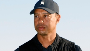 Tiger Woods looks on during the trophy ceremony on the practice green after the final round of the Genesis Invitational golf tournament at Riviera Country Club, Sunday, Feb. 21, 2021, in the Pacific Palisades area of Los Angeles. (AP / Ryan Kang)