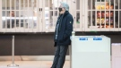 A man wears a face mask as he stands in a shopping mall in Montreal, Saturday, February 13, 2021, as the COVID-19 pandemic continues in Canada and around the world. THE CANADIAN PRESS/Graham Hughes