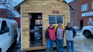 Guy Lamarche [middle] with two friends, visiting his new bunkie location in Arnprior. (Dylan Dyson / CTV News Ottawa)