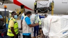 This photograph released by UNICEF Wednesday Feb. 24, 2021, shows the first shipment of COVID-19 vaccines distributed by the COVAX Facility arriving at the Kotoka International Airport in Accra, Ghana. (Francis Kokoroko/UNICEF via AP)