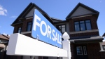 A new home is displayed for sale in a new housing development in Ottawa on Tuesday, July 14, 2020. (THE CANADIAN PRESS / Sean Kilpatrick)