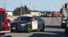 Emergency crews work a the scene of a collision north of Strathroy, Ont. on Wednesday, Feb. 24, 2021. (Marek Sutherland / CTV News)
