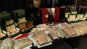 "Police seized a variety of goods totaling $35 million, including cash and high-end cars during ""Project Sindacato."" (CTV News Toronto)"