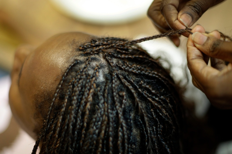 It is now illegal in Tucson, Arizona, to enforce dress code or grooming policies that discriminate against hair texture and hairstyles in the workplace and public schools, officials said. (AP Photo/Charlie Riedel)