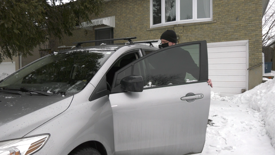 A man gets into his van after battery recharge
