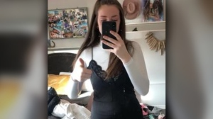 Kamloops, B.C. resident Christopher Wilson says his daughter, Karis, was sent home from high school for wearing a black knee-length dress over a turtleneck. (Christopher Wilson/Facebook)