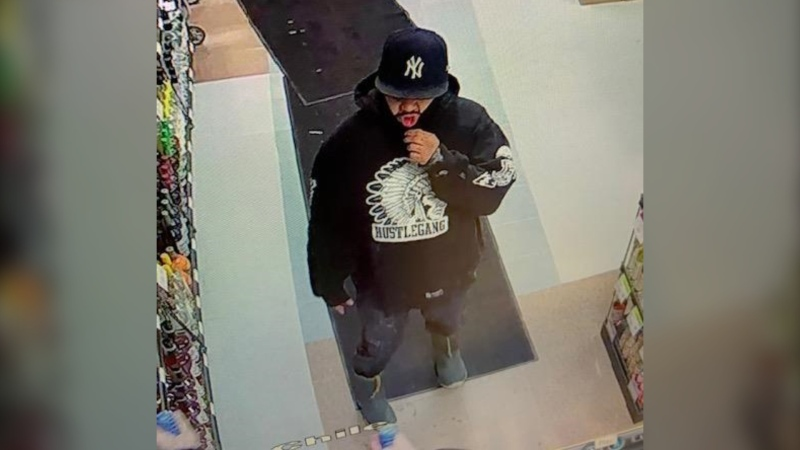 Police are still looking for the other suspect, who was wearing a black 'Hustlegang' sweatshirt, a dark New York Yankees baseball hat, a black face covering and grey boots. (Supplied image)