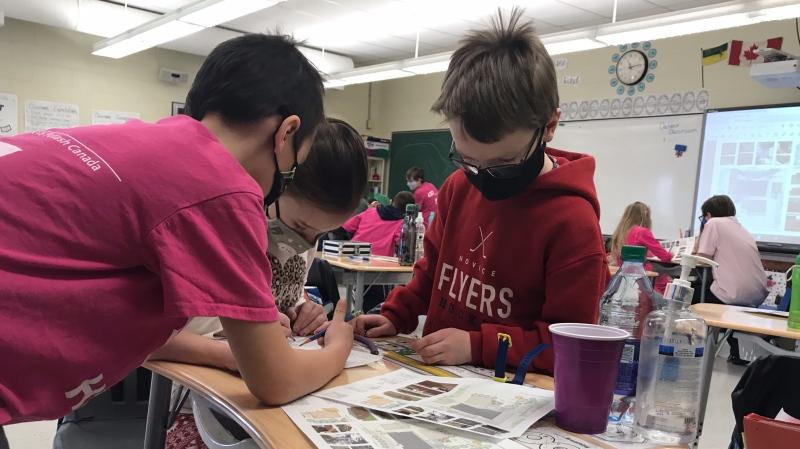 Grade four students at Milestone School work on their outdoor classroom project. (Stefanie Davis/CTV News)