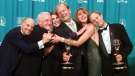"In this Sept. 13, 1998 file photo, cast members of ""Frasier,"" from left, Dan Butler, John Mahoney, Peri Gilpin, Kelsey Grammer, Jane Leeves and David Hyde Pierce, winners of the Emmy for Outstanding Comedy Series, pose backstage at the 50th Annual Primetime Emmy Awards in Los Angeles. (AP Photo/Reed Saxon, File)"