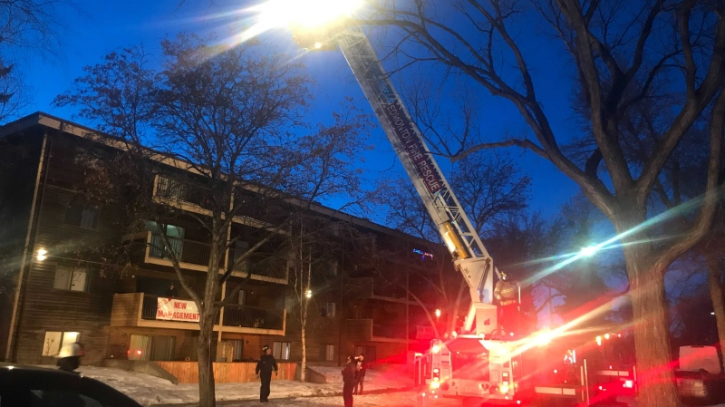 Fire crews at a northeast Edmonton apartment building. Feb. 24, 2021. (Galen McDougall/CTV News Edmonton)