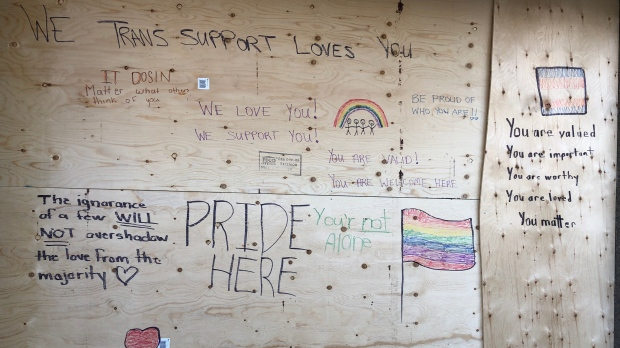 A group of volunteers gathered at the WE Trans office to transform a boarded-up wall after the organization was the target of vandalism in Windsor, Ont. on Wednesday, Feb. 24, 2021. (Alana Hadadean/CTV Windsor)