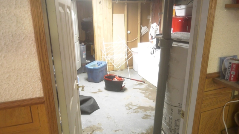 Sewer backup causes flooded basements