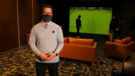 A Calgary golf teacher in search of a venue has launched a golf simulator at a Hotel Arts banquet room