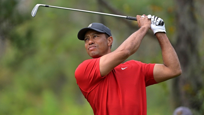 Tiger Woods watches his tee shot on the fourth hole during the final round of the PNC Championship golf tournament in Orlando, Fla., on Dec. 20, 2020. (AP / Phelan M. Ebenhack, File)