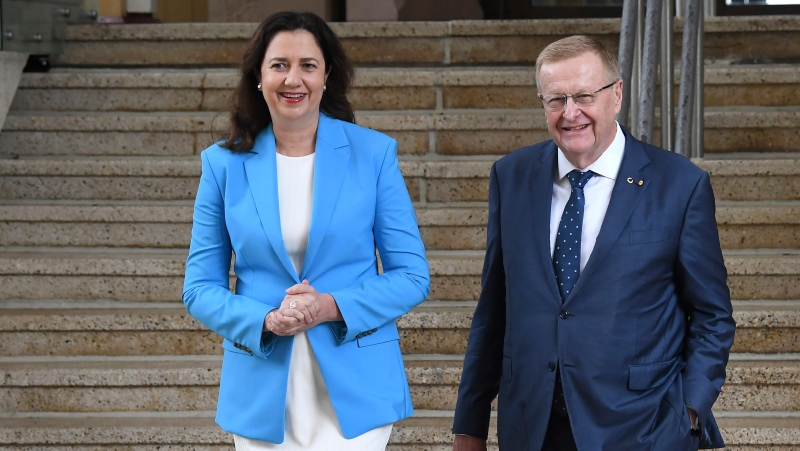 Queensland Premier Annastacia Palaszczuk, left, and AOC President John Coates attend a media conference following news Queensland's bid to host the 2032 Olympics was elevated to preferred bid by the IOC in Brisbane, Australia, Thursday, Feb. 25, 2021. (Darren England/AAP Image via AP)