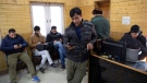 In this Jan. 30, 2020, file photo, Kashmiri journalists browse the internet on their mobile phones inside the media centre set up by government authorities in Srinagar, Indian controlled Kashmir. (AP Photo/Dar Yasin, File)