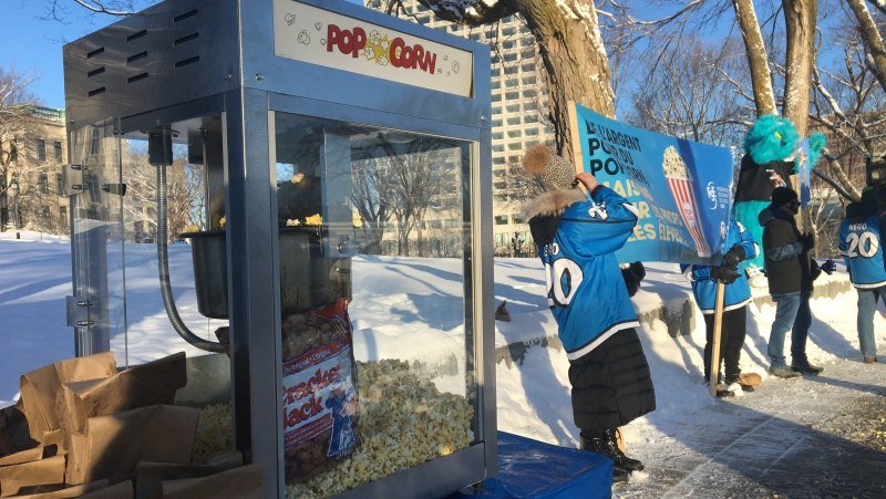 Teachers in Quebec are frustrated at the government compensating cinema owners for losses related to popcorn sales, while a collective agreement remains unsigned. They handed out popcorn at the National Assembly in protest Feb. 25, 2021.