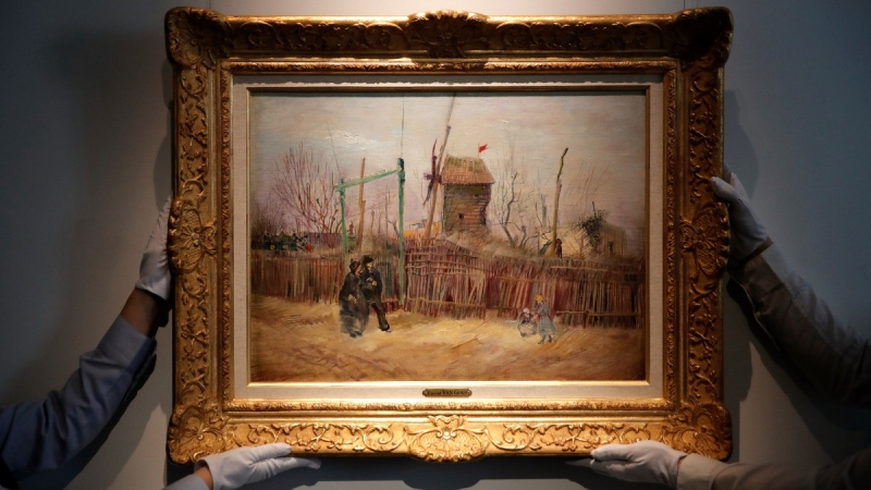 Sotheby's personnel display 'Scene de rue a Montmartre' by Dutch master Vincent van Gogh at Sotheby's auction house in Paris, on Feb. 25, 2021. (Christophe Ena / AP)