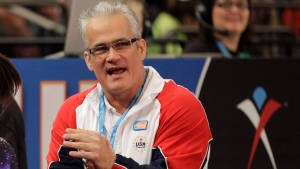 In this March 3, 2012, file photo, gymnastics coach John Geddert is seen at the American Cup gymnastics meet at Madison Square Garden in New York. Prosecutors in Michigan filed charges Thursday, Feb. 25, 2021, against Geddert, a former U.S. Olympics gymnastics coach with ties to disgraced sports doctor Larry Nassar. Geddert was head coach of the 2012 U.S. women's Olympic gymnastics team, which won a gold medal. (AP Photo/Kathy Willens, File)