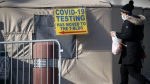 People walk by a Brooklyn hospital offering COVID-19 testing that has seen a rise in coronavirus-related cases on December 15, 2020 in New York City. (Spencer Platt/Getty Images/CNN)