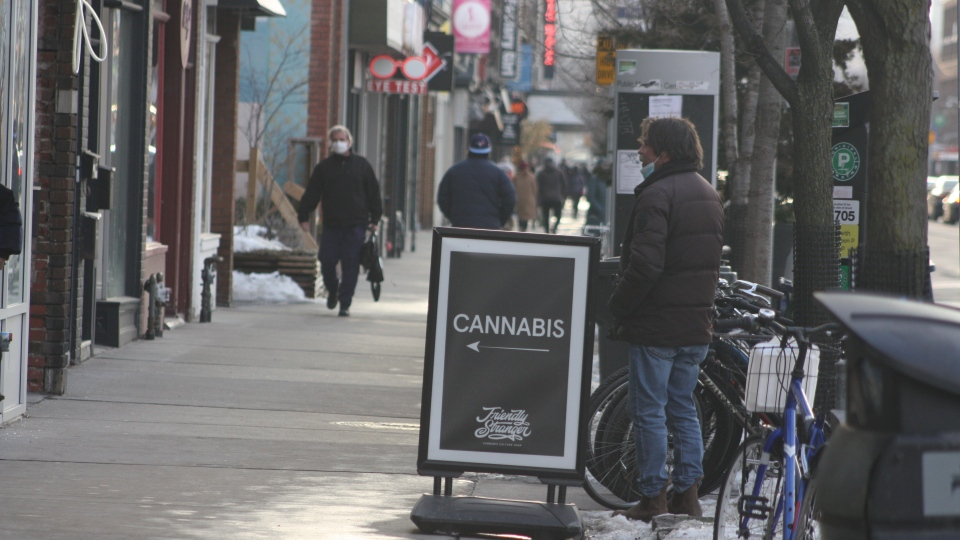 Sandwich board pointing to Friendly Stranger cannabis retail shop on Danforth Avenue in Toronto, on Feb. 25, 2021 (Patrick Cain / CTVNews.ca)