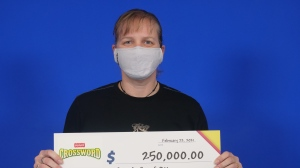Sarah Smith of Ottawa won $250,000 playing Instant Crossword Deluxe. (Photo courtesy: Ontario Lottery and Gaming Corp.)