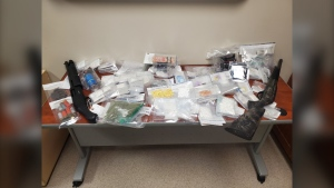 The drugs and weapons RCMP found during a search warrant in Swan River. (Source: Manitoba RCMP)