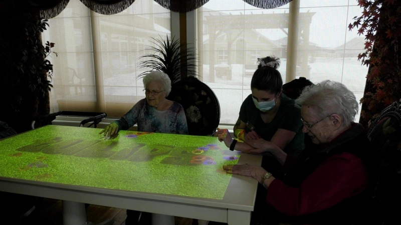 An interactive projector being used at the Diamond House Senior Care home in Warman.