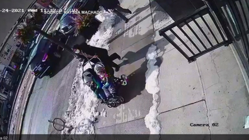 Surveillance video of a woman with a stroller right before she was struck by a vehicle.