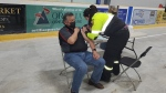 Chief Ted Williams receives a dose of the Pfizer COVID-19 vaccine from his niece on Chippewas of Rama First Nation.  (Supplied)