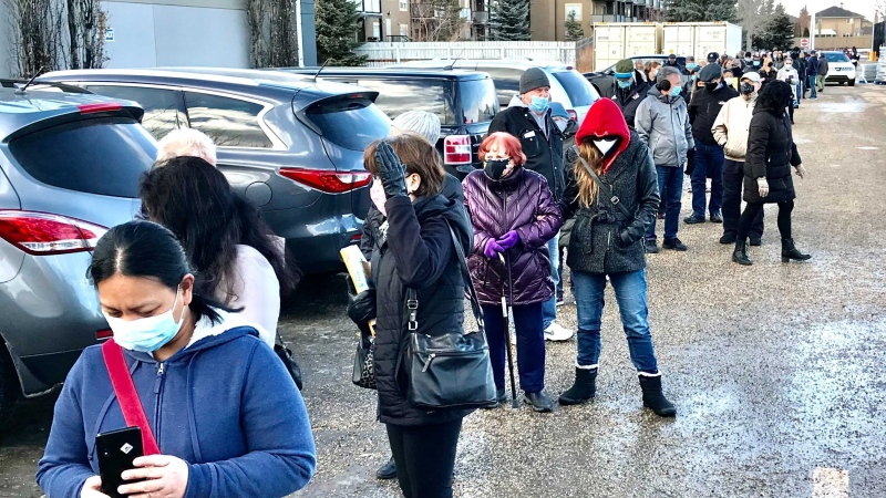 Some Albertans waited more than two hours in line to get their COVID-19 vaccines on Feb. 25, despite having booked an appointment. (Sean Amato/CTV News Edmonton)