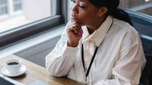 File photo of woman sitting in an office (Pexels)