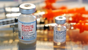 Vials for the Moderna and Pfizer COVID-19 vaccines are displayed on a tray at a clinic set up by the New Hampshire National Guard in the parking lot of Exeter, N.H., High School, Thursday, Feb. 25, 2021, in Exeter. (AP Photo/Charles Krupa)