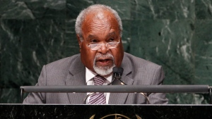In this Sept. 27, 2010, file photo, Michael Somare, Prime then Minister of Papua New Guinea addresses the 65th session of the United Nations General Assembly at UN headquarters. (AP Photo/Seth Wenig, File)