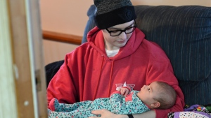 Brian Fraser cradles the daughter of friend Matt Harris in Brockville (Matt Harris/January 2021)