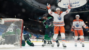 Edmonton Oilers right wing Alex Chiasson (39) celebrates his goal on Vancouver Canucks goaltender Thatcher Demko (35) during second period NHL action in Vancouver, Thursday, February 25, 2021. THE CANADIAN PRESS/Jonathan Hayward