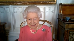 In this undated handout photo provided by Buckingham Palace on Thursday, Feb. 25, 2021, Britain's Queen Elizabeth smiles on a video call with the four health officials leading the deployment of the COVID-19 vaccination in England, Scotland, Wales and Northern Ireland. (Buckingham Palace via AP)